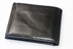 倒空在白色背景的黑皮革钱包 库存图片
