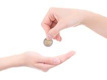 倒空女性拿着欧洲硬币的棕榈和手被隔绝在白色 库存图片