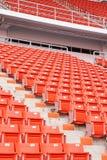倒空红色体育场位子 库存照片