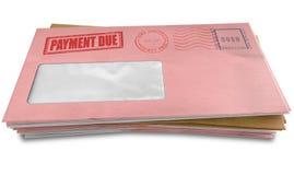 债务信封堆 图库摄影
