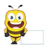 倾斜在一个空白的标志的蜂 库存图片