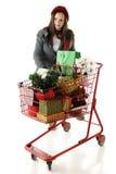 倾斜在圣诞节购物车 免版税库存图片