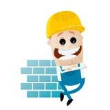 倾斜在墙壁的滑稽的动画片建筑工人 库存照片
