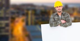倾斜在广告牌的建筑师在城市 免版税图库摄影