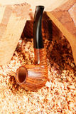 倾斜的管道抽烟的木头 库存图片
