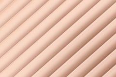 倾斜的粉红色窗帘 免版税库存照片
