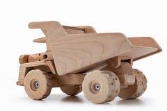 倾销者玩具汽车由木头制成 免版税库存图片