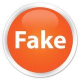 假优质橙色圆的按钮 免版税库存图片