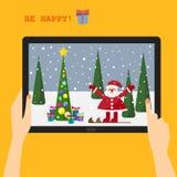 假日与微笑的圣诞老人的贺卡 库存照片