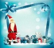 假日与礼物盒和圣诞老人的圣诞节背景 免版税图库摄影