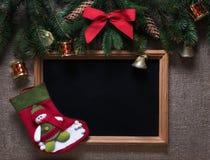 假日圣诞节在一棵圣诞树的分支戏弄与框架的 免版税库存照片