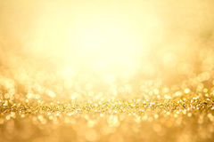 假日背景的抽象金光 免版税库存图片