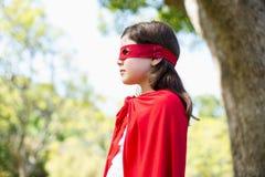 假装的女孩是超级英雄 图库摄影