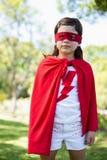 假装的女孩是超级英雄 库存照片