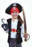 假装被掩没的女孩是海盗 免版税库存图片
