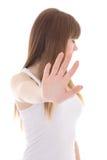 做一个停车牌用手的十几岁的女孩被隔绝在白色 免版税库存图片