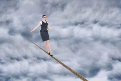 做一次平衡操作的女实业家的综合图象 库存照片