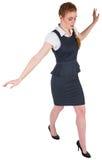 做一次平衡操作的女实业家 图库摄影