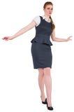 做一次平衡操作的女实业家 免版税图库摄影