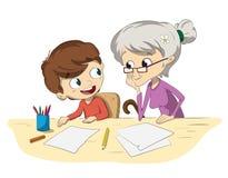 做与他的祖母的孩子家庭作业 免版税库存照片