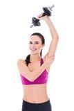 做与哑铃孤立的体育穿戴的亭亭玉立的妇女锻炼 免版税库存照片