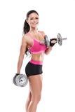 做与大哑铃的好性感的妇女锻炼,被修饰 免版税库存图片