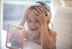 做与微笑的家庭作业 图库摄影
