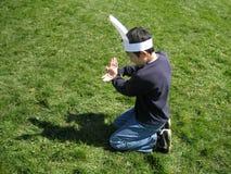 做与手阴影的男孩复活节兔子 免版税库存照片