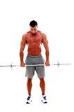 做与杠铃的肌肉人锻炼 免版税图库摄影