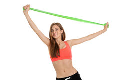 做与理疗的磁带乳汁磁带的运动少妇锻炼 免版税库存图片