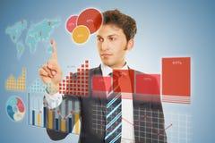 做与触摸屏幕的商人财政规划 免版税库存照片