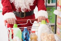 做买菜的圣诞老人 库存照片