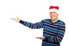 做人介绍圣诞老人的帽子 免版税库存图片