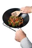 做人铁锅的食物 免版税库存照片