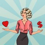 做出在爱和金钱之间的妇女一个选择 2 business woman 库存图片