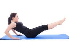 做力量的运动的妇女为腹肌isol行使 库存照片