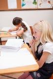 做功课的学生画象  免版税库存照片