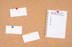 做名单和通知在插脚板 库存图片