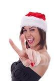 做圣诞老人胜利妇女 库存图片