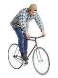 做在一辆自行车的年轻人把戏在白色 图库摄影