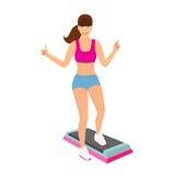 做在健身房的美丽的妇女有氧锻炼-被隔绝 免版税库存图片