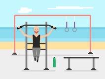 做在单杠的有胡子的爱好健美者人引体向上在一间室外健身房 免版税图库摄影