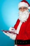 做在愿望的圣诞老人附注 免版税库存照片