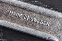 做在瑞典文本在板钳把柄 免版税库存图片