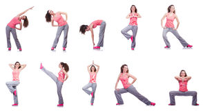 做在白色的年轻女性锻炼 免版税库存图片
