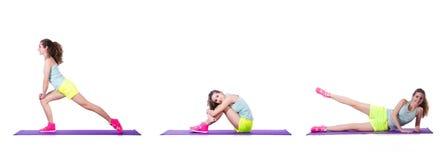 做在白色的年轻女性锻炼 免版税图库摄影