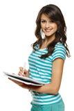 做在笔记本的学员妇女附注 免版税库存照片