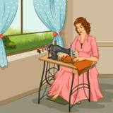 做在缝纫机的减速火箭的妇女礼服 免版税库存照片