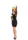 做多士用香槟的晚礼服的美丽的妇女。 免版税库存照片