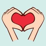 做形状的手指心脏 免版税库存照片